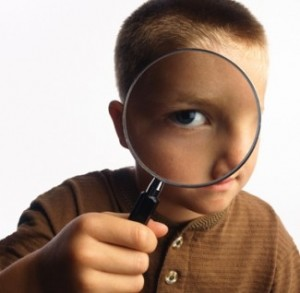 boy-with-magnifying-glass-325x318